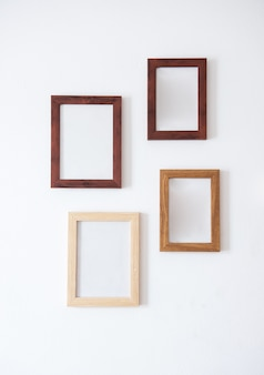 Wooden frame. wood blank picture frames in different sizes on wall. museum gallery mockup design, advertising painting image templates