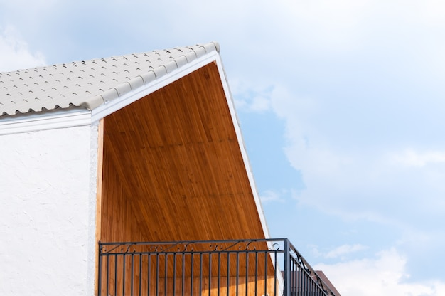 Wooden gabled roof with blue sky,triangles roof house sky background