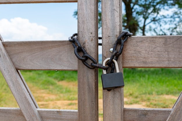 Wooden gate with chain and padlock