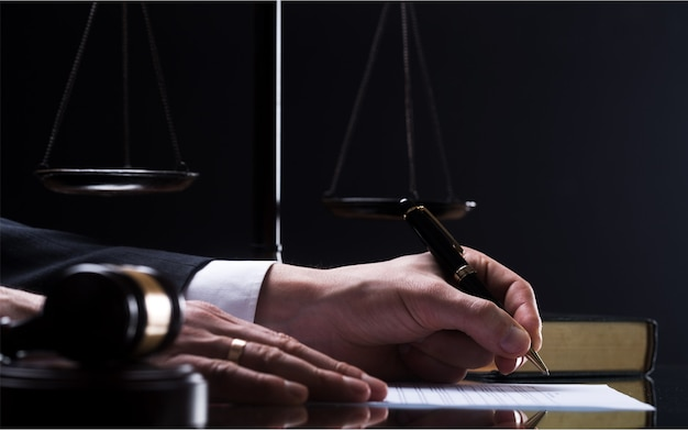 Wooden gavel on table. attorney working in