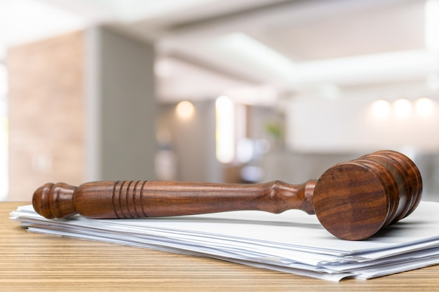 Wooden gavel on table close up. justice concept
