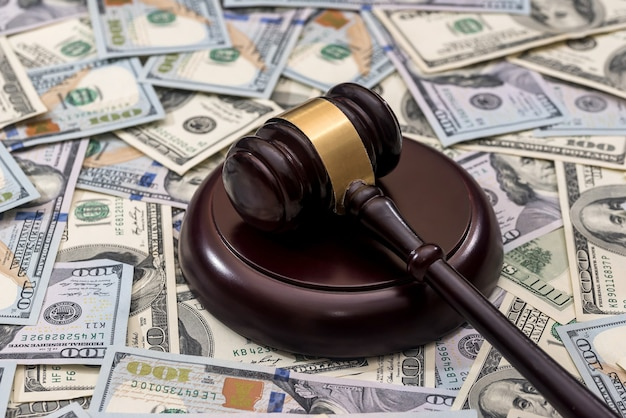Wooden gavel on us dollar banknote