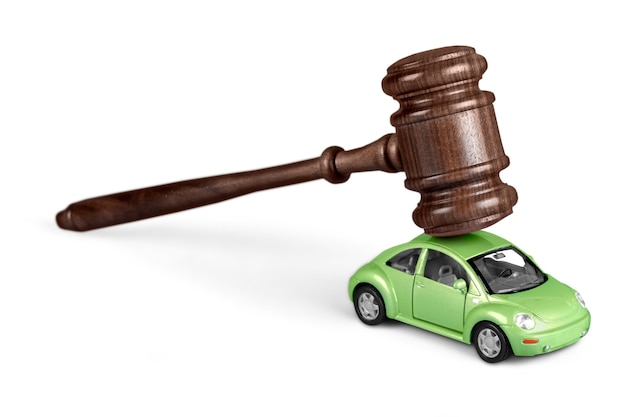 Wooden gavel with car  on  background