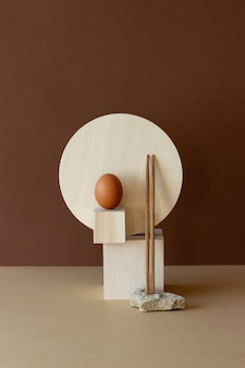Wooden geometric shapes, stone, sticks and egg. still life. concept. product design.