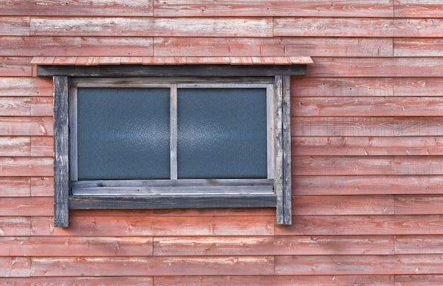 Wooden and  glass window in the redwood wall - image