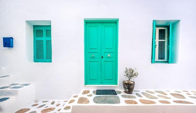 The wooden green door