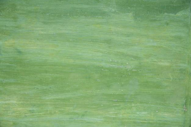 Деревянный зеленый окрашенный фон. текстура дерева.