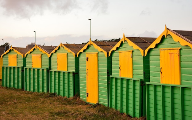 Wooden green and yellow cottages in the rural area