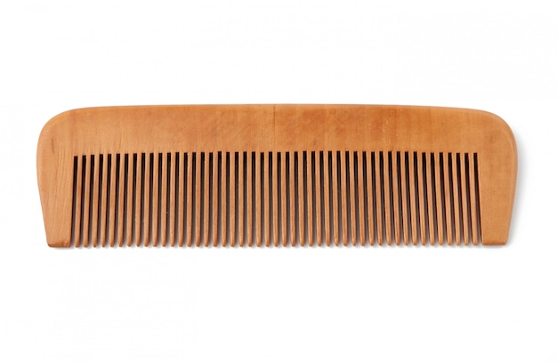 Wooden hairbrush isolated on a white surface