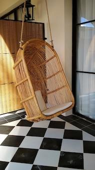 Wooden hammock chair on the balcony