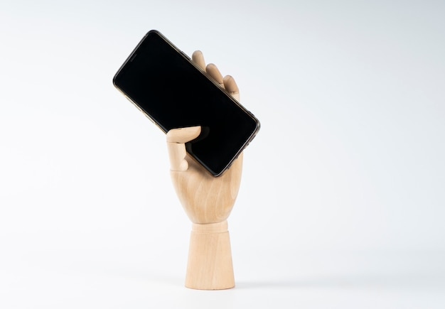 Wooden hand grabbing a mobile