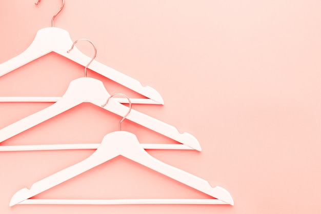 Wooden hangers toned living coral color