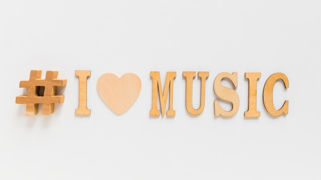 Wooden harsh sign and i love music text isolated on white background
