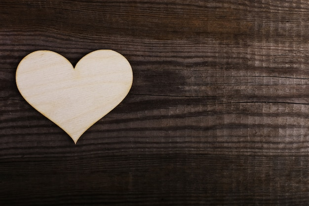 Wooden heart on the old table