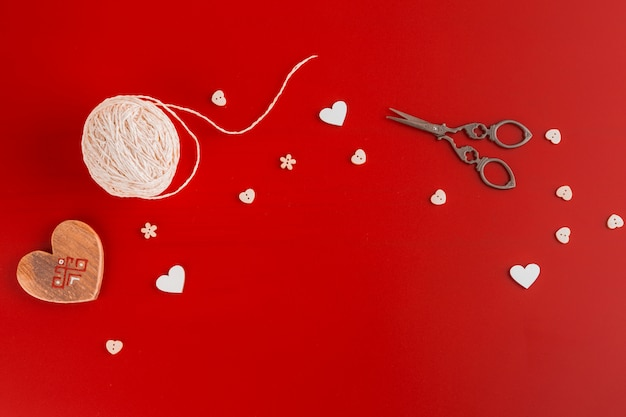Wooden heart with ball of yarn