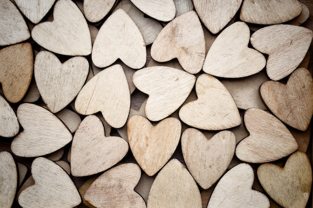 Wooden hearts, on the heart background.