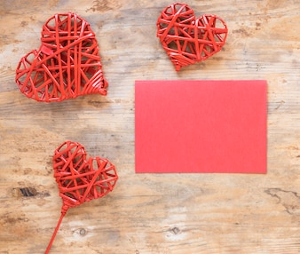 Wooden hearts with blank paper