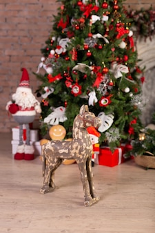 Wooden horse in front of the christmas tree. free space. copy space.