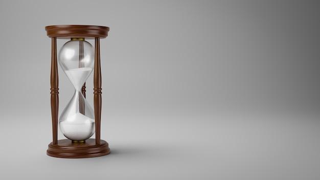 Деревянные песочные часы на сером фоне