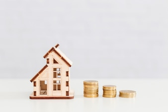 Wooden house and coins stack