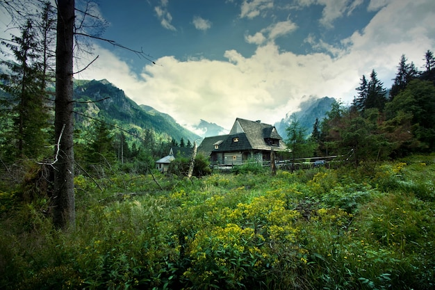 Wooden house in beautiful mountains scenery