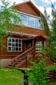 Wooden house in the forest. individual construction of cottages.
