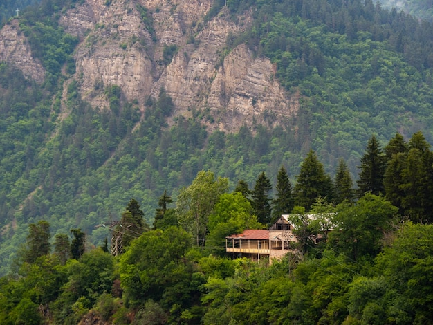 Wooden house lost in mountains forest. atmosphere of quiet solitude. introverts heaven.