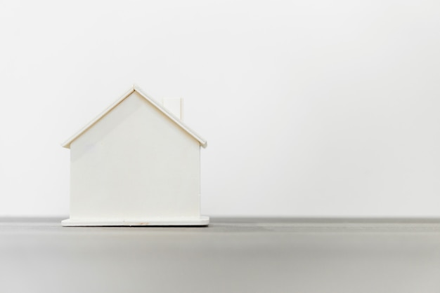 Wooden house model for real estate and construction concepts