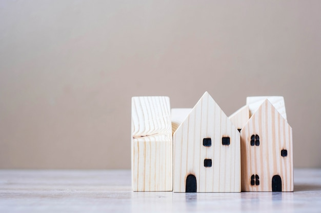 Wooden house model on table background.