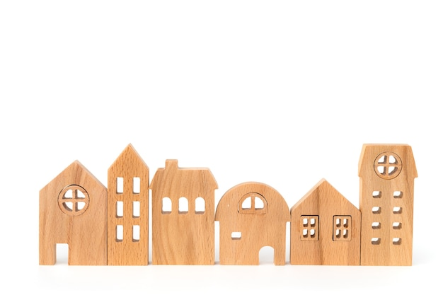 Wooden house model on white isolated for housing and property concept