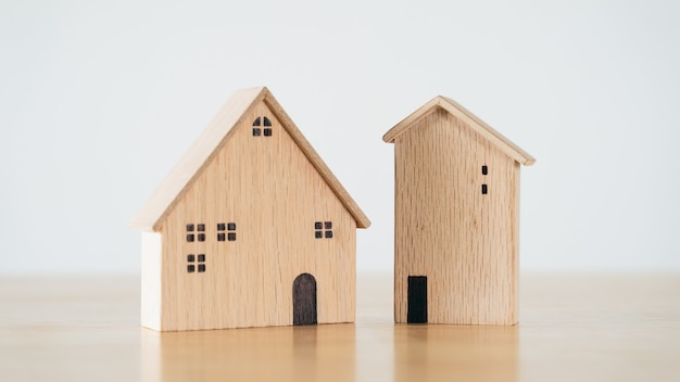 Wooden house on wooden table. buying house, financial plan home loan concept.