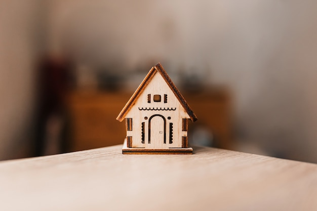 Wooden house on wooden table