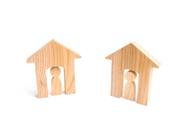Wooden houses and people on a white background.