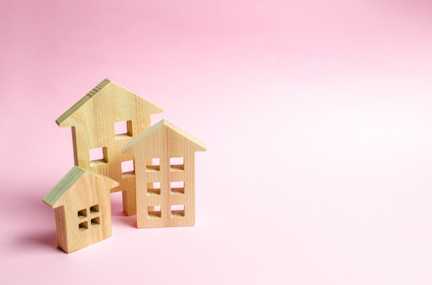 Wooden houses on a pink background.