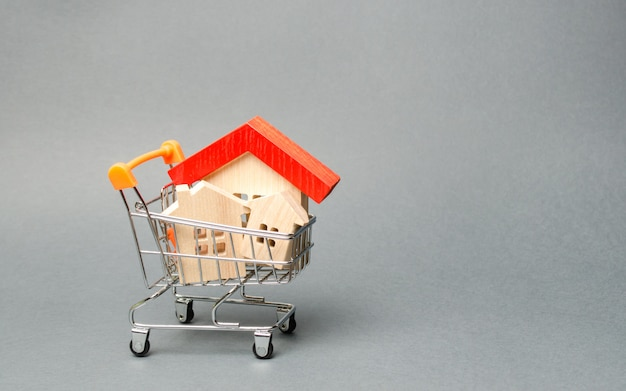 Wooden houses in a supermarket trolley.