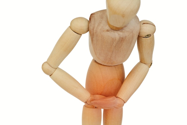 Wooden human with stomach pain.