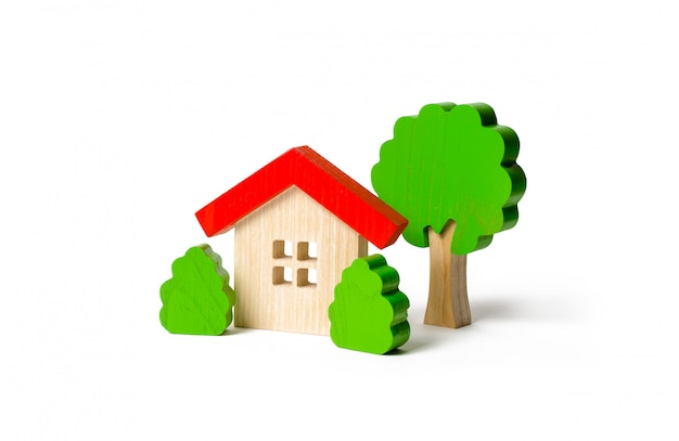 Wooden hut and tree figurines with bushes