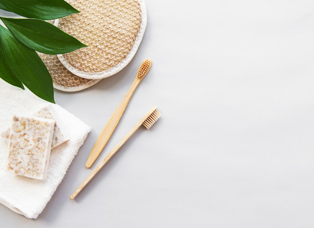 Wooden hygienic bathroom utensils on white background