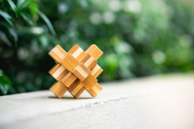 Wooden interlocking on green nature background