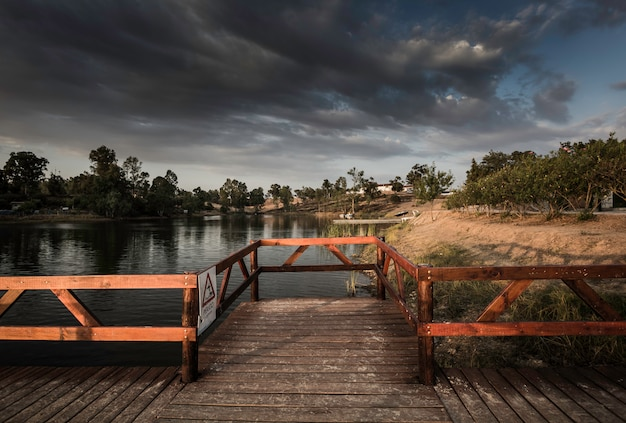 Wooden jetty and gazebo over the lake in sao domingos mine
