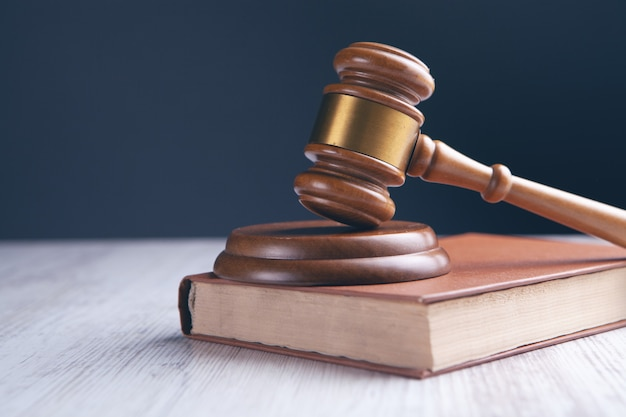 Wooden judge gavel and law book