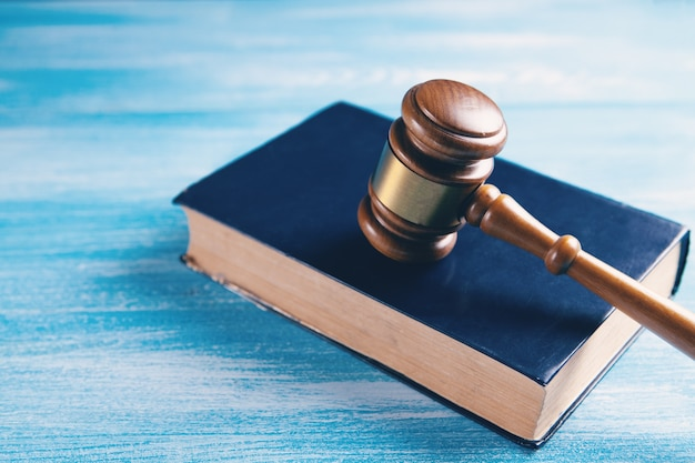 Wooden judge gavel and law books