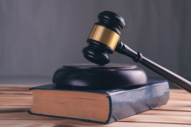 Wooden judge gavel and law books.