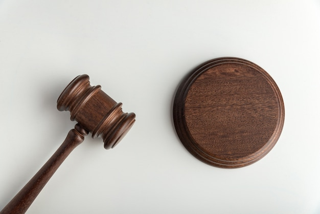 Wooden judge gavel and sound board.