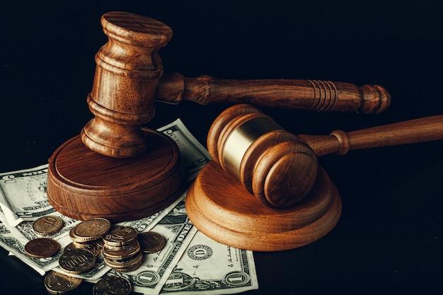 Wooden judge gavel on us dollar banknotes closeup. justice corruption concept