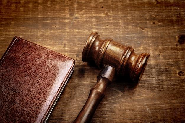 Wooden judge hammer on notepad