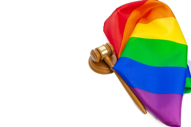 Wooden judge mallet and lgbt rainbow flag isolated. law and lgbt