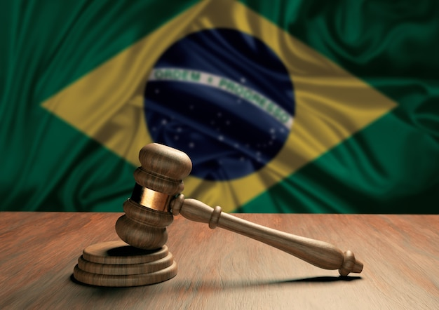 Wooden judge's gavel symbol of law and justice with the flag of brazil. brazilian judicial system. 3d rendering