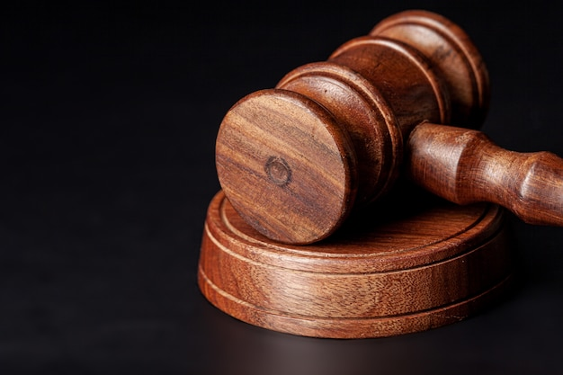 Wooden judges gavel on table close up