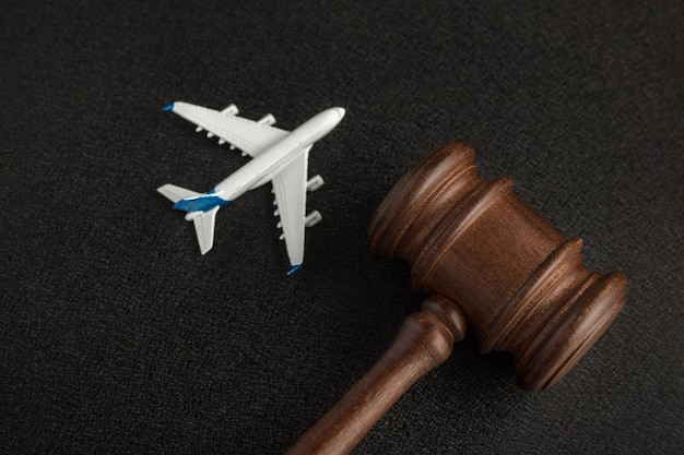 Wooden judges gavel and toy plane. aviation law.